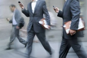 businessmen-using-mobile-phones-while-walking